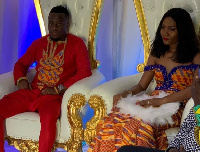 Mr. and Mrs. Accam seated at their wedding ceremony
