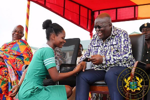 President Akufo-Addo exchanging pleasantries with a nurse during the restoration of nurses allowance
