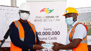 Senyo Hosi receiving the cheque on behalf of the Ghana COVID-19 Private Sector Fund