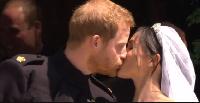 Prince Harry and Meghan share a kiss on the steps outside St George's Chapel