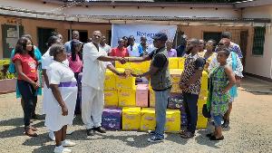 Rotary Club's Mr. Kwaku Tweneboah Ofosu [R] making the presentation to Emmanuel Pappoe [L]