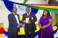 Dr Adu Boateng and Mrs Deborah Paintsil receiving the award