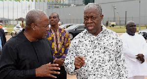 Amissah-Arthur (R) with his former boss John Mahama