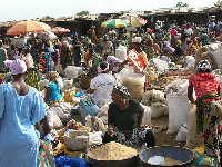 Traders at the market.     File photo.