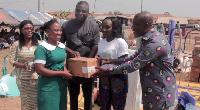A nurse from a beneficiary hospital receives the medical items from Nana Yaa and Kojo Oppong Nkrumah