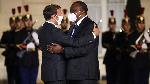Kenya's President Uhuru Kenyatta and French President Emmanuel Macron (left) when they met in Paris