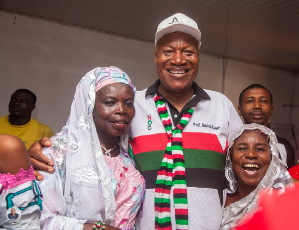 Prof. Joshua Alabi [C] with some supporters