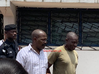 Colonel Samuel Kojo Gameli (in white ) and Gershon Akpa being escorted from the court last Friday