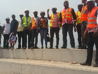 Isaac Asiamah (4th from right) with the CEO of NYA and staff of the construction company at the site