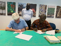Joseph Boahen Aidoo, Chief Executive of COCOBOD signing an agreement with Israel to combat CSSVD
