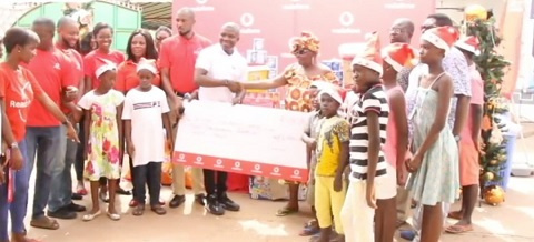 Vodafone Ghana presenting some items and cash to one of the orphanages they visited