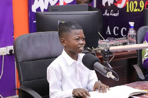 9-year-old Dominic Fobih in the studios of Angel FM on Thursday.