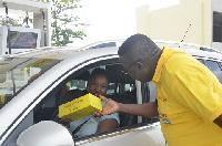 The Managing Director of Vivo Energy Ghana, Mr. Ebenezer Faulkner presenting a gift to a customer