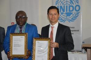 MD, QCC, Nana Karikari receiving the certificate from Juan Pablo of UNIDO