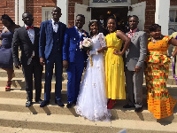 Brother Adu Patrick with his wife and friends and family