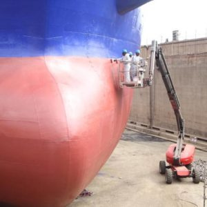 Workers of Tema Shipyard Limited working on a vessel in the drydock