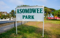 A signpost at Asomdwee Park in Accra