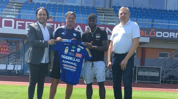Paintsil (second right) with official of his new club during the unveiling