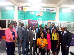 Staff of Opportunity International in a group photo with Botsyo Nkegbe