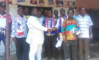 Amoah Yawson (left) welcoming the defectors into the NPP