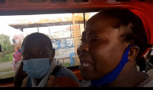 A passenger arguing with the driver and his mate