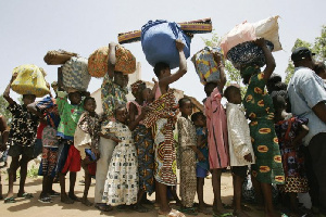 Nigerina Refugees In Queue Cameroon 696x464