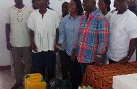 Samuel Atta Akyea presenting items to the SOS Village Director