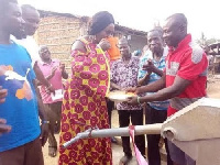 Barbara Oteng-Gyasi , MP for Prestea-Huni Valley Constituency with some residents of Kangakrom