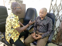 Alhaji Ibrahim Tanko (right) speaking to the reporter