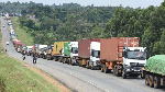 Slow Covid-19 testing result in long queues such as this on Bungoma-Malaba highway, (PHOTO | NMG)