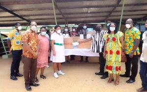 Madam Rita Botsoe receiving the items from Togbe Awalie III
