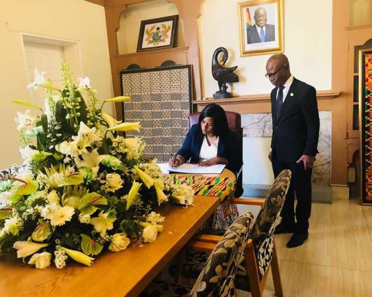 Ms. Babara O.Neresa, Ugandan High Commissioner to South Africa, signing the book of condolence