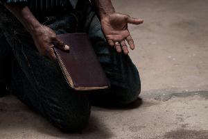 File photo of a Christian man praying
