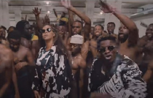 The young man was stucked behind Beyonce like 'glue'