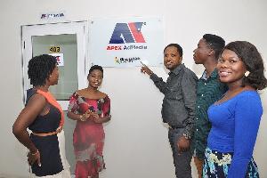 Charles Ntiamoah-Mensah with some staff of Ghanaweb at the premises