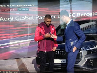 Kevin-Prince Boateng receiving his new car from a Barca official