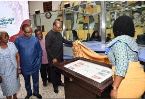 Dr Ernest Addison, Governor of Bank of Ghana unveiling specimen of the new denomination