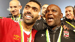 Al Ahly head coach Pitso Mosimane celebrating with a player