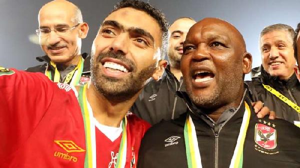 Al Ahly coach Pitso Mosimane (right)
