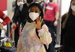 Simone Biles waves to the crowds after she and her teammates landed in Tokyo ahead of the Olympics
