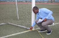 Emmanuel-Dasoberi measuring the length of the goal post