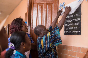 Officials unveiling a plaque to mark completion of the renovated four-classroom block