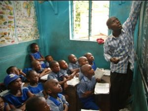 Teacher in class with schoolchildren, this is the time to teach the children about corruption