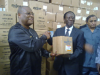 James Ohemeng-Kyei (2nd right) handing over the drugs to Alex Segbefia