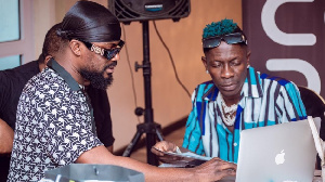 Dancehall artiste, Shatta Wale with music producer, Mix master Garzy