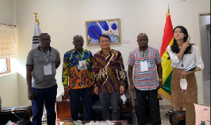 Ahafo Regional Minister, George Boakye in a photograph with South African and Denmark investors