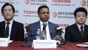 Santosh Varghese [middle] addressing the media