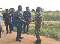 Col. Kwadwo Damoah (in smock) in a chat with a Togolese Gendarme at the Kpoglo border post