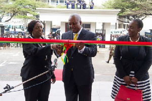 Mahama accompanied by the Chief Justice Georgina Theodora Wood, left and the Attorney General