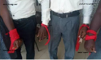 Members of CETAG had hung red bands to signify the activation of a first of industrial action